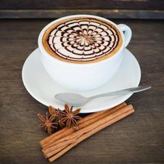 latte art coffee on wooden background