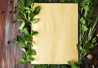 Open recipe book with fresh herbs and spices
