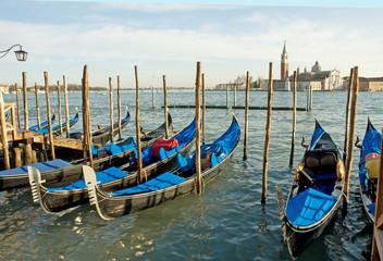 Venice, Italy, gondola parking at sunset.
