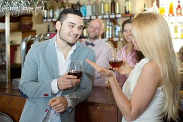 Restaurant visitors drinking wine