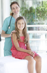 Pediatrician with her patient