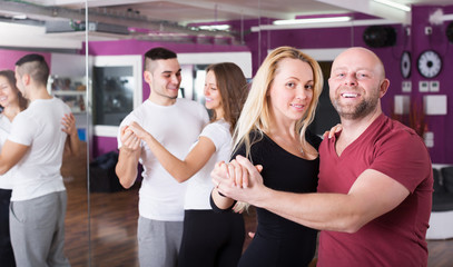 Couples enjoying of partner dance