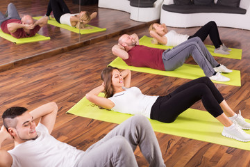 Adults having group fitness class