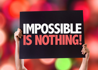 Impossible is Nothing card with bokeh background