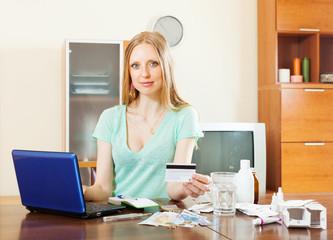 Blonde   girl choosing medication in online pharmacy