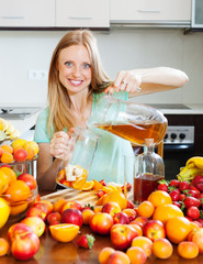 girl pouring fresh beverages with fruits