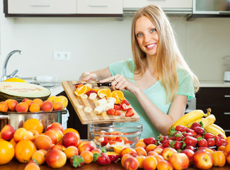 woman making fruit salad