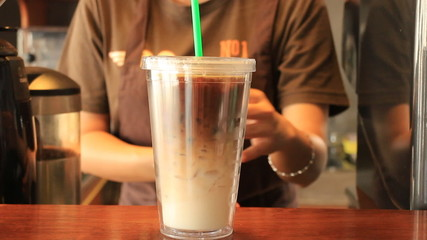 Barista Serving Doublewall Glass Of Iced Coffee Latte
