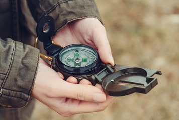Hiker woman with a compass outdoor