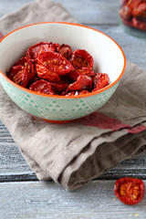 Sun dried cherry tomatoes in a bowl on napkin