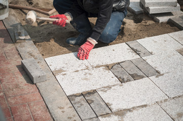 Construction worker installing the pavestone