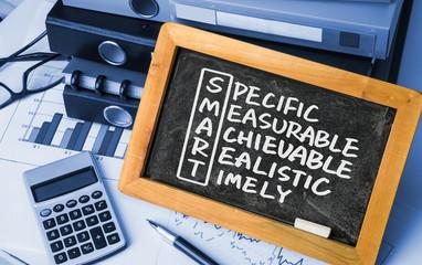 smart crossword handwritten on blackboard
