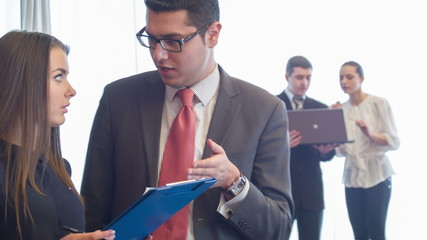 Selective focus on businesslike man standing discussing some