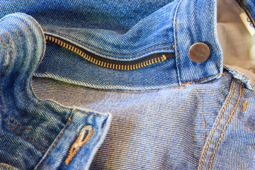 close up of blue jeans texture with open zipper