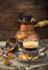 cup of coffee in vintage with caramel brown sugar crystals