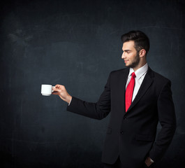 Businessman holding a white cup