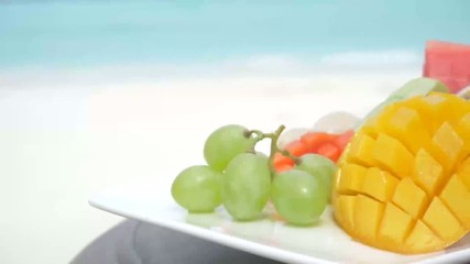delicious fruits served on the sandy Maldives beach
