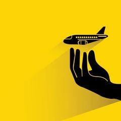 hand holding plane