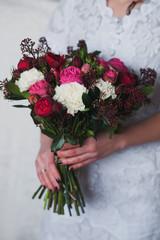 Beautiful bright bridal bouquet in bride hands