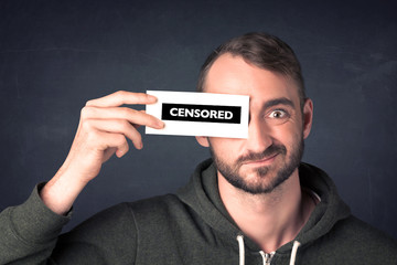 Funny guy with censored sign paper