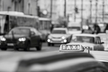 taxi on city streets in monochrome tones