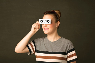 Silly youngster looking with hand drawn eye paper