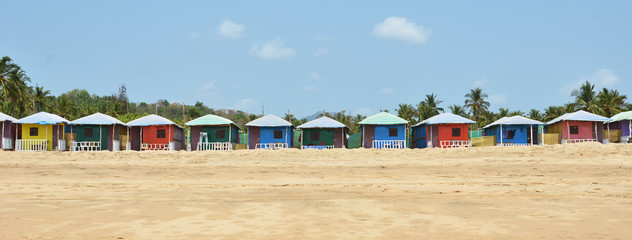 Colorful huts on Agonda beach. South Goa, India