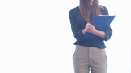 Selective focus on young standing woman