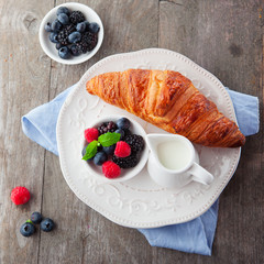 Fresh croissant and berries