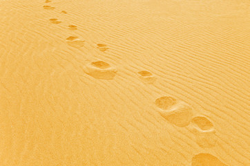 Foot step on the sand
