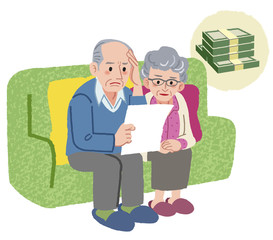 シニア 悩み Aged couple sitting on the sofa and checking bills