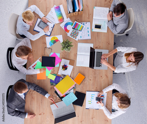 Business people sitting and discussing at business meeting, in - 81385175