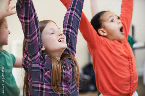 Group Of Children Enjoying Drama Class Together - 81385341