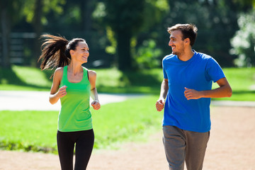 Happy couple jogging outdoor