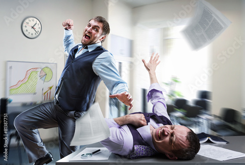 Businessmen fighting in the office - 81387751