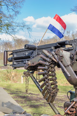 Military machine gun with bullets and dutch flag