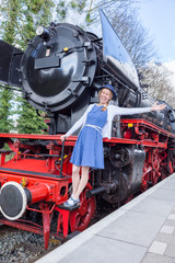 European woman expressing happiness on steam train
