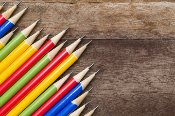 colorful pencils on wooden background