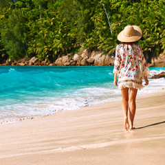 Woman with sarong on beach at Seychelles