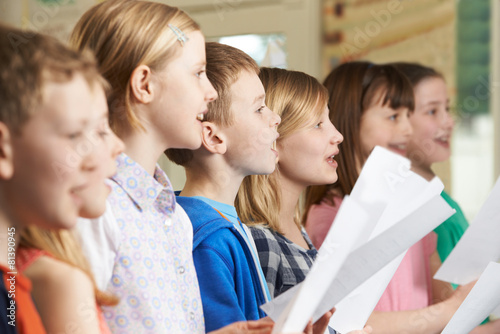 Group Of School Children Singing In School Choir - 81390945