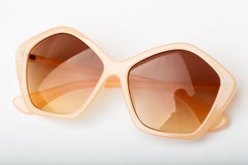 Black sunglasses on a white background