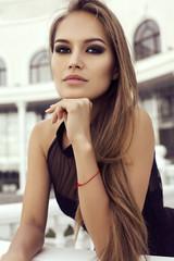 beautiful woman with long hair in elegant black dress