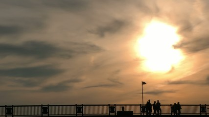 People Silhouette on Bridge and Sunset Time Lapse