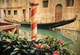 Vintage gondola moored on a venetian canal - Venice, Italy