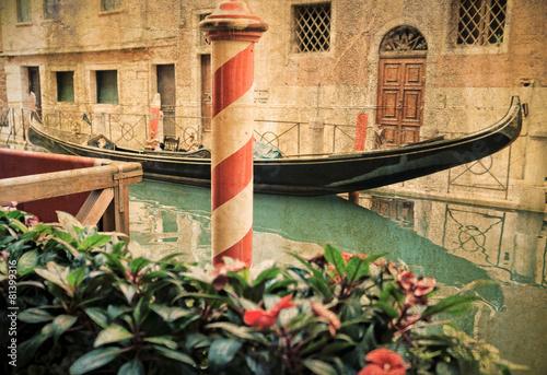 Deurstickers Gondolas Vintage gondola moored on a venetian canal - Venice, Italy