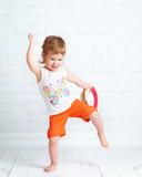 Fototapety happy beautiful baby girl dancer dancing  hip hop dance