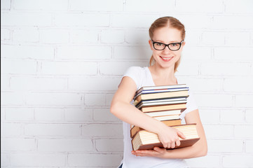 Happy successful student girl with book