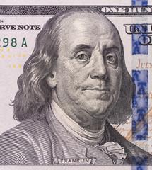 close-up portrait of Franklin with hundred dollar bills