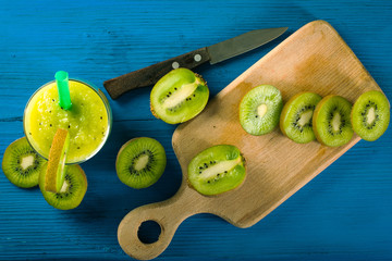 Green Smoothies of kiwi on a bright blue background