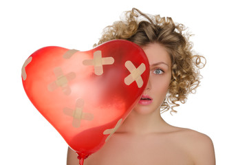 Balloon in shape of heart and upset woman